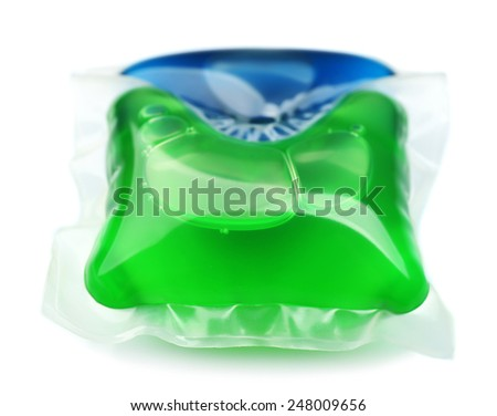 Gel capsule with laundry detergent isolated on white - stock photo