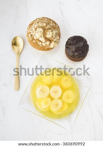 gelatin dessert with banana on white marble - stock photo