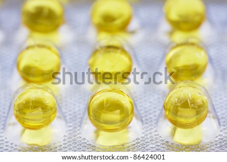 Gelatinous capsules with the vitamin A close up - stock photo