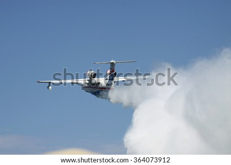 Gelendzhik, Russia - September 9, 2010: Beriev Be-200 multipurpose amphibian plane showing its firefighting water dropping abilities