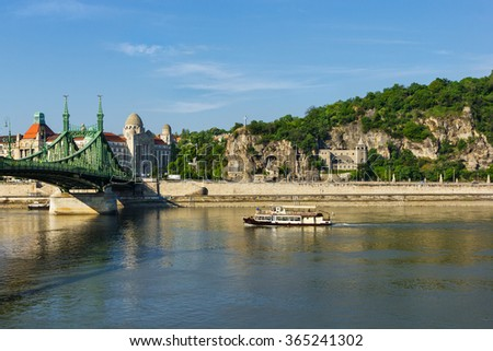 Gellert zone and Liberty bridge over Danube in Budapest Hungary - stock photo