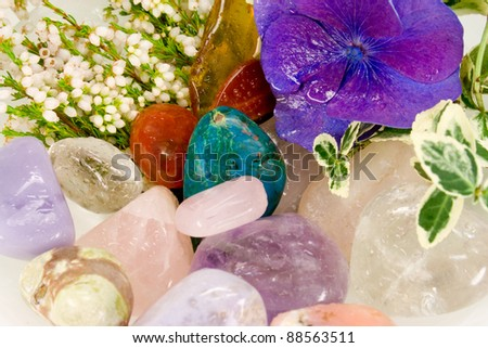 Gemstones for therapy with blossoms - stock photo