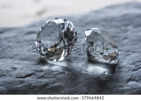 gemstones on grey blue rock - stock photo