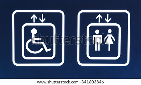 General and Handicap Accessible Elevator Sign, toilet - stock photo