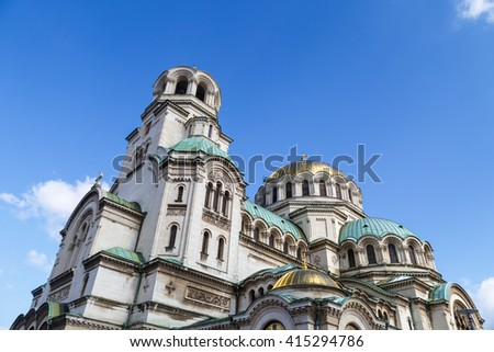 General bottom view of famous Bulgarian Orthodox church of Alexander Nevsky Cathedral built in 1882 in Sofia, Bulgaria, on blue sky background. - stock photo