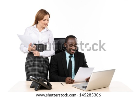 General manager and his secretary at office
