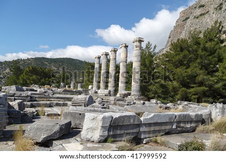 General temple view of Priene Ancient City in Aydin, Turkey, on bright blue sky background.