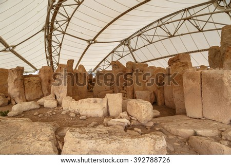 General view of ancient limestone structures of Hagar Qim and Gnajdra Temples in Qrendi, Malta. - stock photo
