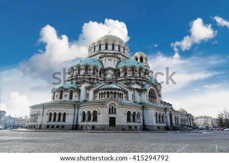 General view of famous Bulgarian Orthodox church of Alexander Nevsky Cathedral built in 1882 in Sofia, Bulgaria, on cloudy blue sky background. - stock photo