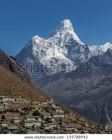 General view of the village Khumjung on the background of Ama Dablam (6814 m) - Nepal, Himalayas - stock photo