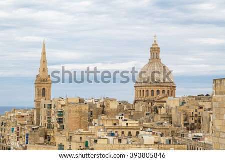 General view of Valletta cityscape at Malta island with historical limestone buildings from medieval times. - stock photo