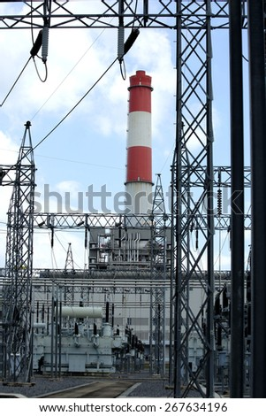 general view to high-voltage substation with switches and gas power plant, gas generator