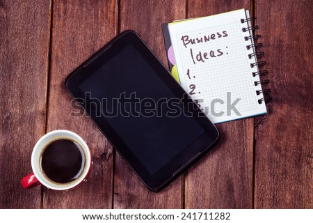 Generating business ideas for start up. Cup of black coffee, tablet, notebook with a list on the table. Weekday office worker. Desktop surface. Cup of coffee on the table - stock photo