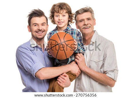 Generation portrait. Grandfather, father and son, isolated a white background. Boy holding in hands ball. - stock photo