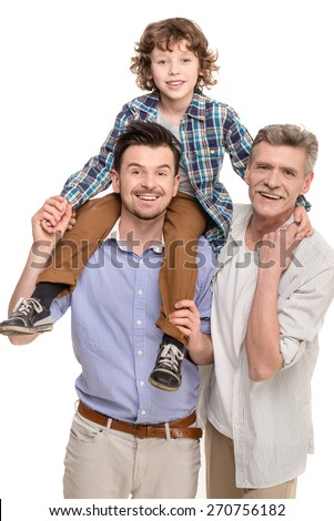 Generation portrait. Grandfather, father and son looking at camera isolated a white background. - stock photo