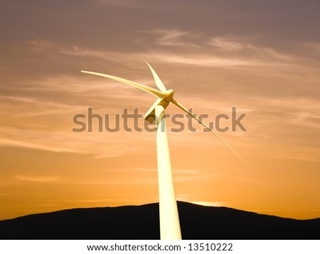 generator electricity to wind in sunset - stock photo