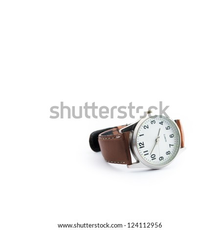 Generic analog wrist watch with Arabic numerals and tan leather band on white background.