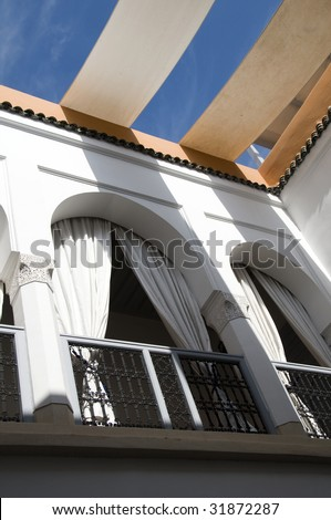 generic architecture of arch with railing in riad house villa in marrakech marrakesh morocco