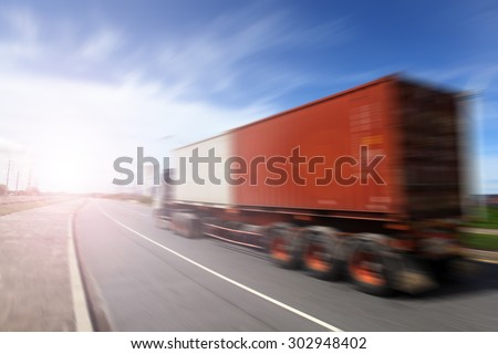 Generic big trucks speeding on the highway at sunset - Transport industry concept , big truck containers  - stock photo
