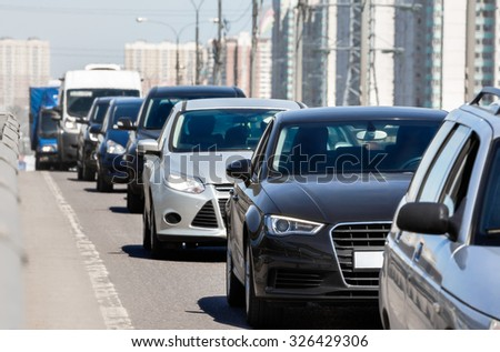 Generic cars standing in a queue during traffic jam. - stock photo