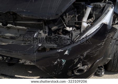 Generic compact car damaged in a rollover accident. Car crash wreck - insurance concept