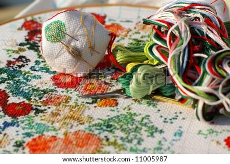 generic flowers on textile (cross stitch) - stock photo