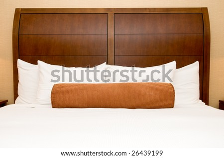 Generic hotel/motel room with queen-size bed - stock photo