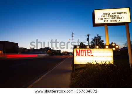 Generic Motel sign in the dusk on road - stock photo