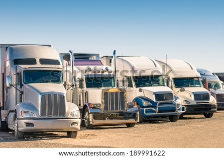 Generic semi Trucks at a parking lot - stock photo