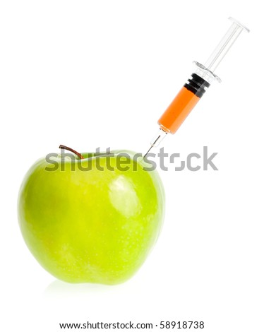 Genetic modification concept with green apple receiving an injection - stock photo