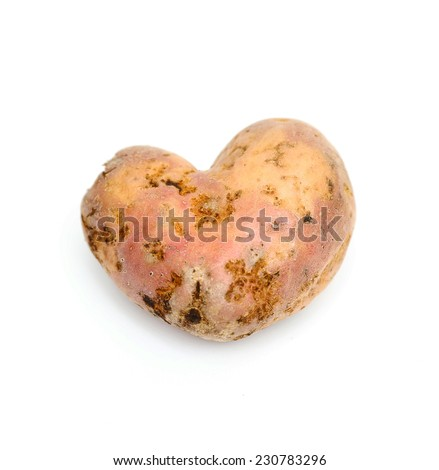 Genetically modified potatoes in the form of heart on Valentine's Day - stock photo