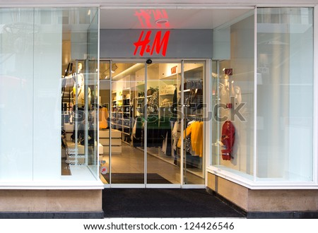 GENEVA -Â?Â? DECEMBER 15: A branch of the retail clothing chain H&M Hennes & Mauritz AB, December 15, 2012 in Geneva, Switzerland. H&M exists in 43 countries and in 2011 employed around 94,000 people.