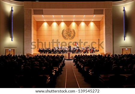 GENEVA - JANUARY 22:  Antoine Marguier conducts the United Nations Orchestra at the UN Palais January 22, 2013 in Geneva, Switzerland celebrating the 50th anniversary of the Elys�©e Treaty. - stock photo