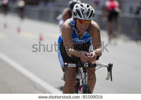 GENEVA - JULY 24: Athlete competing in the cycling section of the 2011 ITU Triathlon European Cup, July 24, 2011 in Geneva, Switzerland