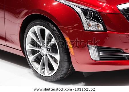 GENEVA, MAR 4: Cadillac ATS wheel and headlight detail, presented at the 84th International Motor Show in Geneva, Switzerland on March 4, 2014. - stock photo
