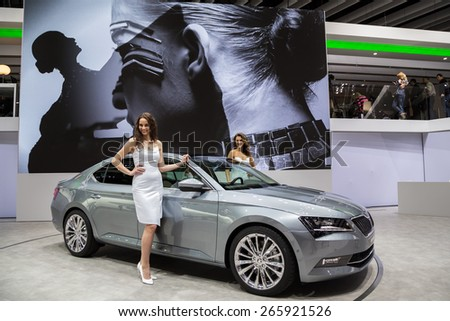 GENEVA, MAR 3: Skoda Superb car with models, presented at the 85th International Motor Show in Geneva, Switzerland on March 3, 2015.  - stock photo