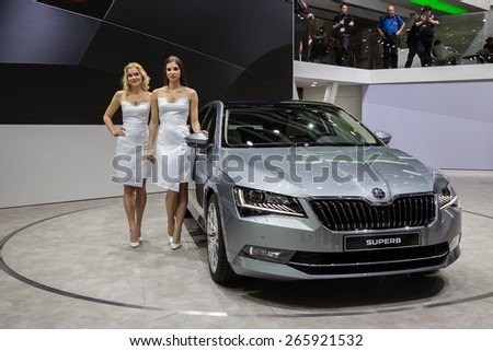 GENEVA, MAR 3: Skoda Superb car with models, presented at the 85th International Motor Show in Geneva, Switzerland on March 3, 2015.  - stock photo