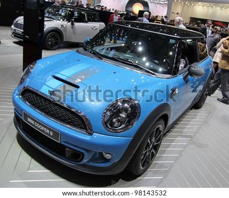 GENEVA - MARCH 16 : blue Mini Cooper S Bayswater on display at the 82st International Motor Show Palexpo -Geneva on March 16; 2012 in Geneva, Switzerland. - stock photo