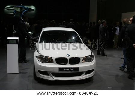 GENEVA - MARCH 2: The BMW 120d on display at the 81st International Motor Show Palexpo-Geneva on March 2, 2011 in Geneva, Switzerland. - stock photo