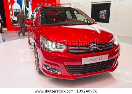 GENEVA - MARCH 8: The Citroen C4 on display at the 81st International Motor Show Palexpo-Geneva on March 8, 2011 in Geneva, Switzerland. - stock photo