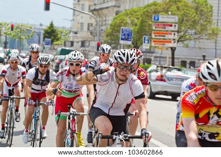 GENEVA - MAY 27: Unidentified athletes competing in the 2012 Cyclotour of Lake Geneva, May 27, 2012 in Geneva, Switzerland. The Cyclotour consists of three races of 180km, 110 and 60km. - stock photo