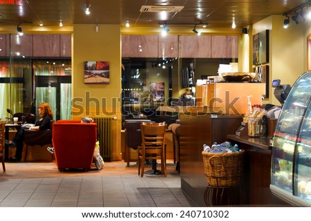 GENEVA - SEP 15: Starbucks cafe interior on September 15, 2014 in Geneva, Switzerland. Starbucks is the largest coffeehouse company in the world, with more then 23000 stores - stock photo