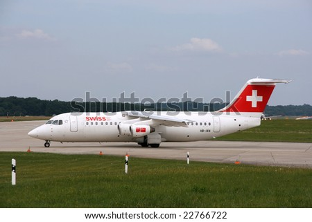 GENEVA, SWITZERLAND - 16 AUGUST 2008: Avro 146 RJ100 jet aircraft operated by Swiss at Geneva Cointrin International Airport on August 16, 2008.
