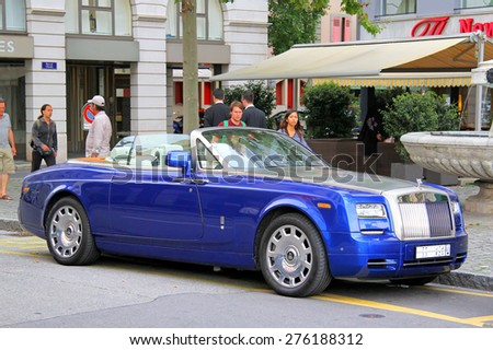 GENEVA, SWITZERLAND - AUGUST 4, 2014: Modern luxury car Rolls-Royce Phantom Drophead Coupe at the city street. - stock photo