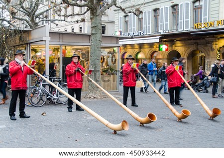 GENEVA, Switzerland DEC 5, 2015 - Men blowing swiss alp horns in Rive, Geneva, Switzerland during Christmas season.