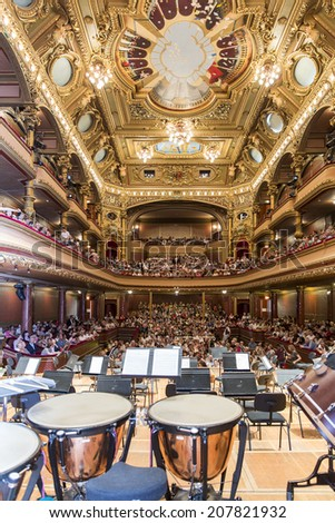 GENEVA, SWITZERLAND - JUNE 22, 2014: The audience awaits the United Nations Orchestra the concert performance at the Victoria Hall during a free concert as part of the city's festival of music. - stock photo