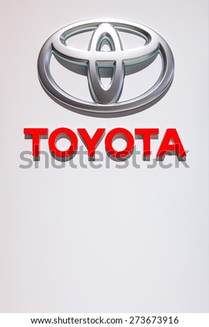 GENEVA, SWITZERLAND - MARCH 3, 2015: A Toyota sign at the Geneva Motor Show. Toyota sold 9 million vehicles in 2014, has 330,000 employees and had net revenue of 25,691,911 million yen in 2014.