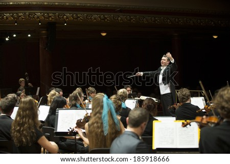 GENEVA, SWITZERLAND  MARCH 21, 2014: Antoine Marguier conducts the UN Orchestra at the Spring Concert 2014 in the  Victoria Hall.