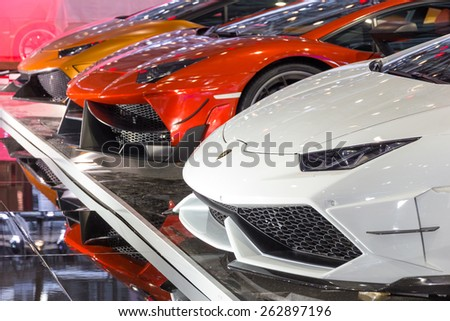 GENEVA, SWITZERLAND - MARCH 3, 2015: Customized Lamborghini supercars from DMC Exotic Car Tuning LTD at the 85th International Geneva Motor Show in Palexpo, Geneva. - stock photo
