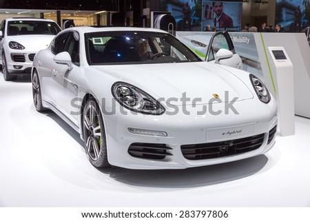 GENEVA, SWITZERLAND - MARCH 4, 2015: Porsche Panamera S e-hybrid car at the 85th International Geneva Motor Show in Palexpo. - stock photo